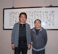公司董事长张伟宗与朵云轩字画鉴定专家陈勉合影