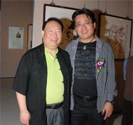 公司董事长张伟宗与书法家陆康合影